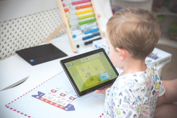Child uses tablet to play Scottie Go!
